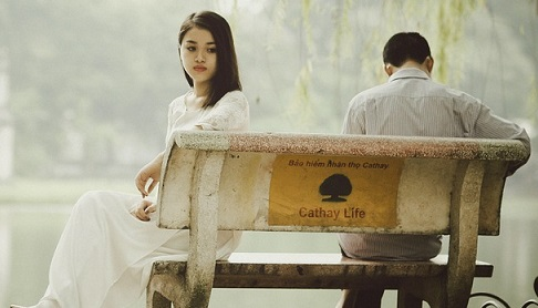 sad lady and man in bench