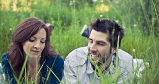 Couple lying in grass
