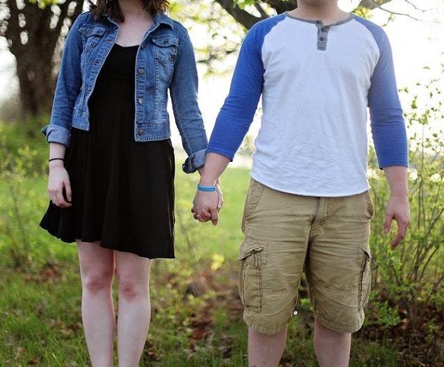 couple lovingly holding hands