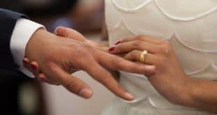 couple wearing wedding ring