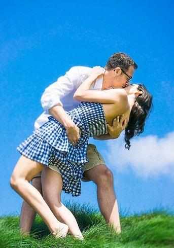 man bending to kiss lover