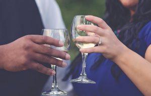 engaged couple celebrating