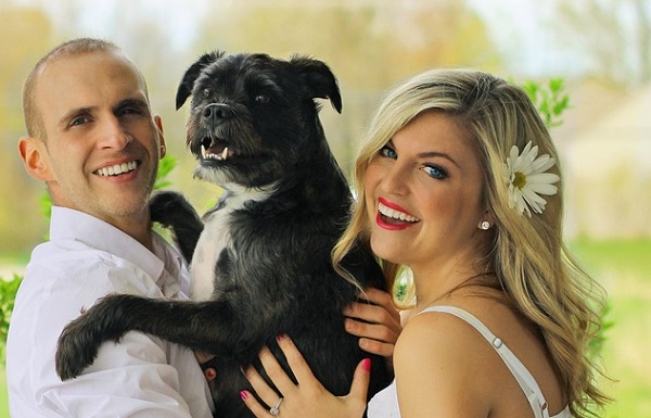 happy couple with pet