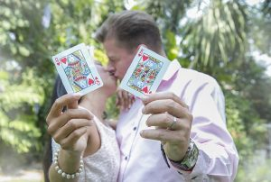 married couple showing cards