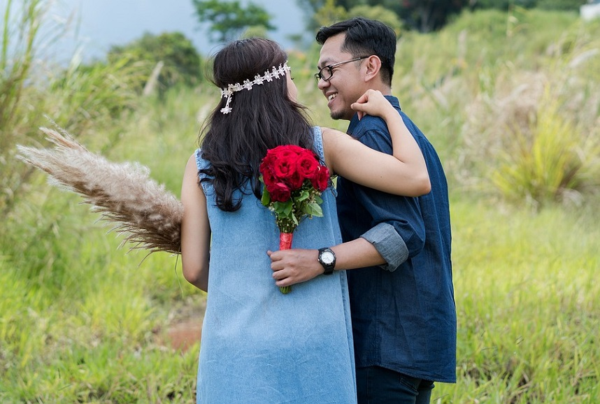 romantic partners with flowers